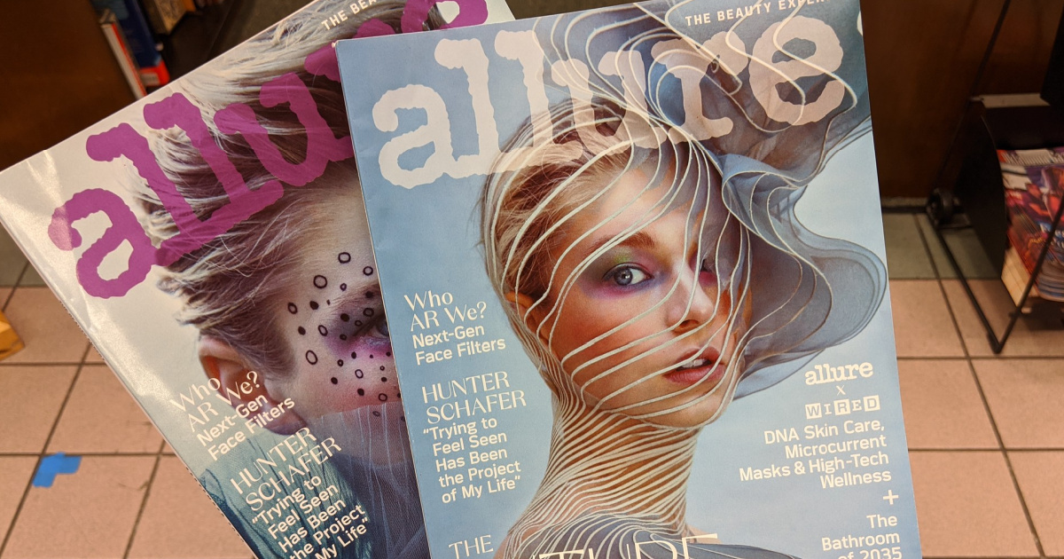 hand holding two allure magazines in store