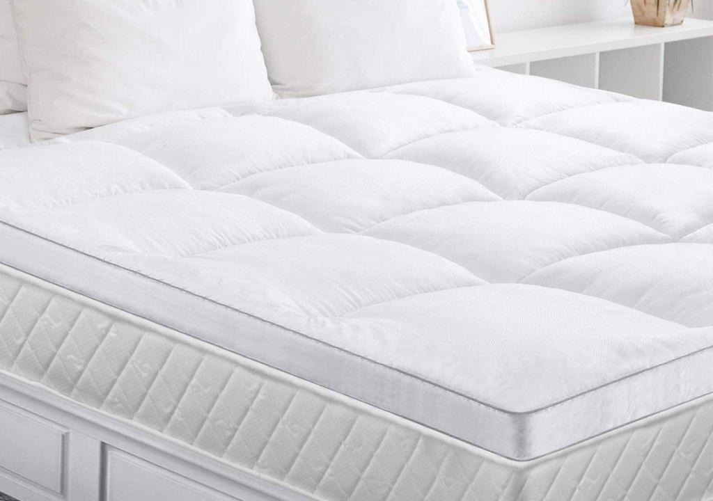 white down alternative mattress topper on a mattress