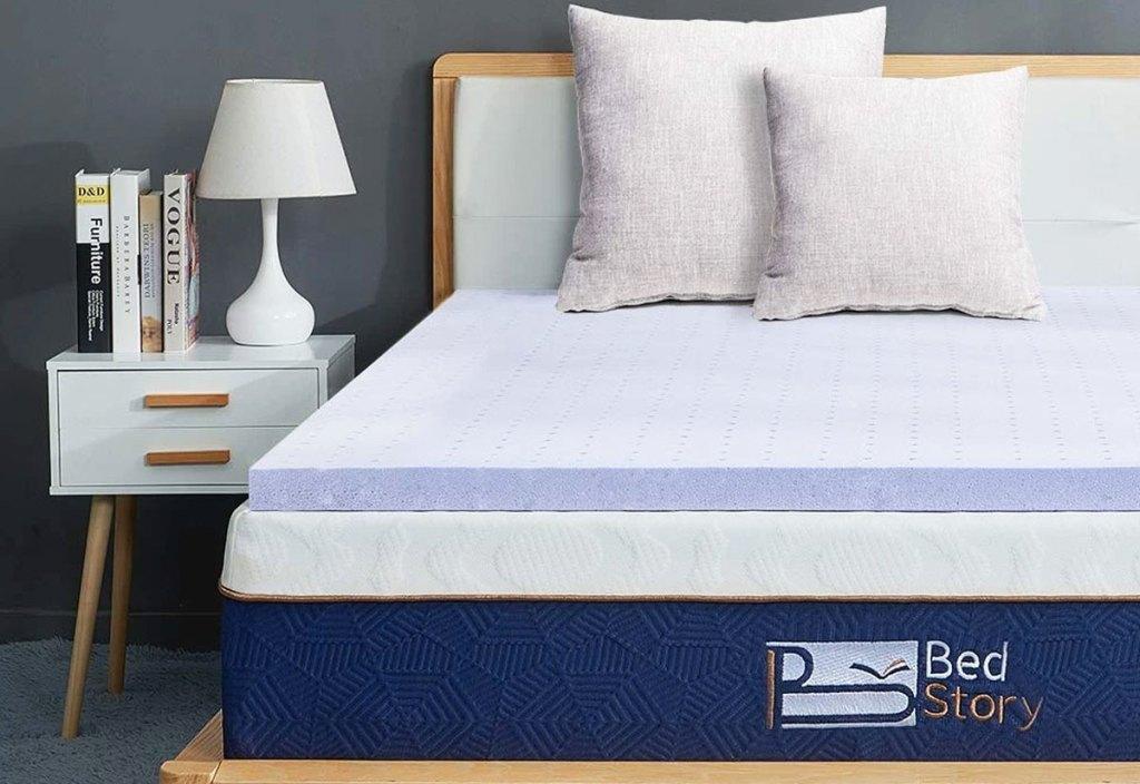 purple colored memory foam mattress topper on a bed