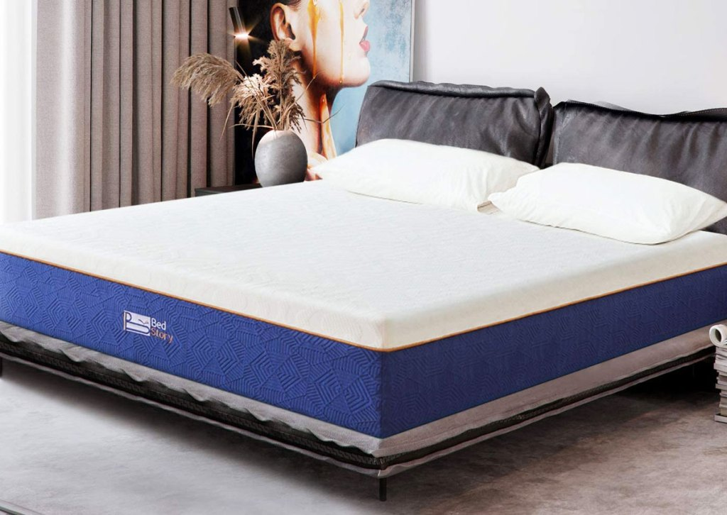 white and blue memory foam mattress in bedroom with pillows on top