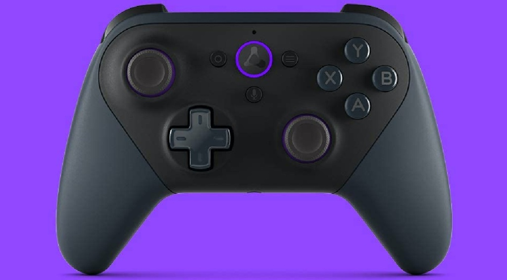 black gaming controller and purple background