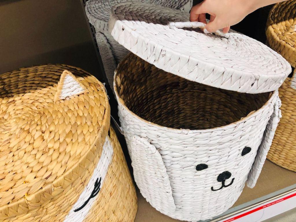 hand lifting lid on Animal Basket at ALDI