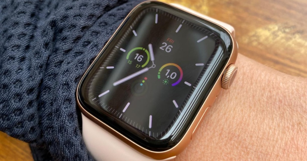 pink and gold Apple Watch on wrist