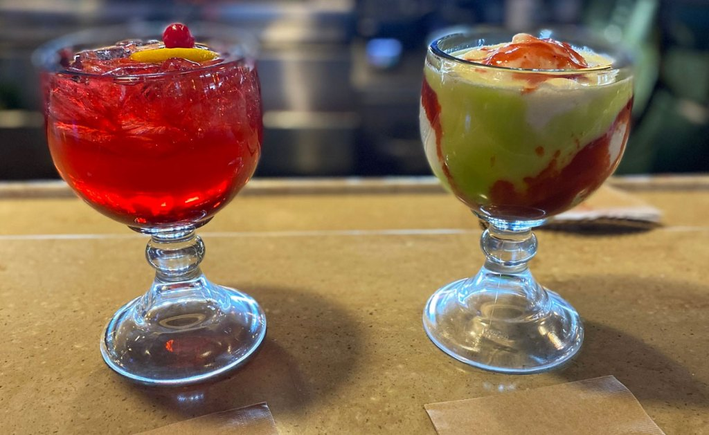 two holiday themed adult drinks on bar at applebees