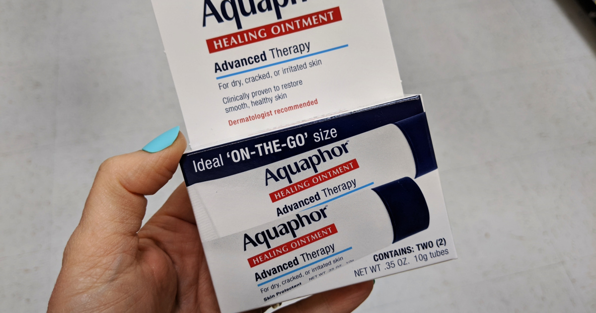 hand holding Aquaphor Healing Ointment