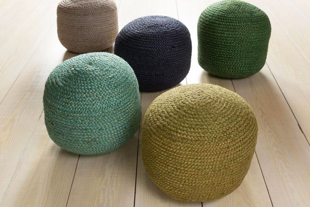 woven accent poufs in multiple colors on wood floor
