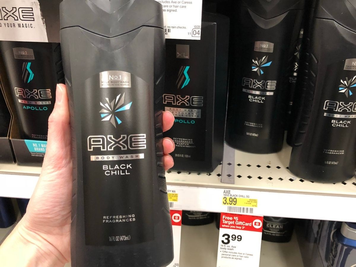 Woman's hand holding up bottle of Axe Body Wash