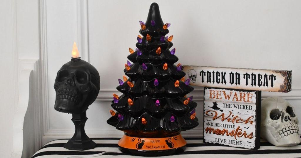 Halloween tree with decorations around it