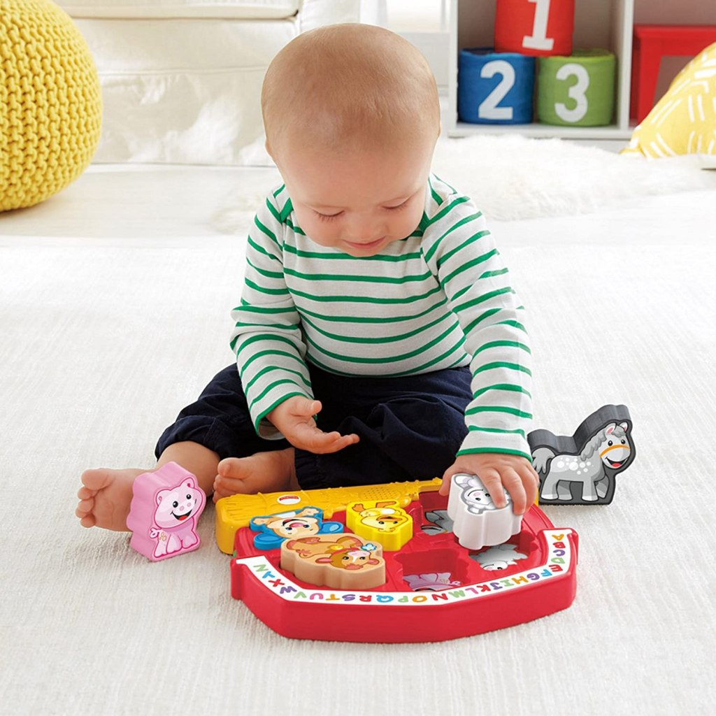 Baby Playing with Farm Puzzle