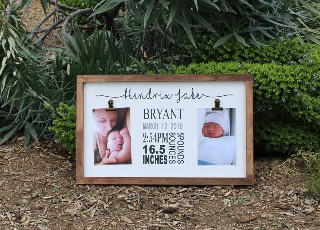 sign with baby pictures and birth information
