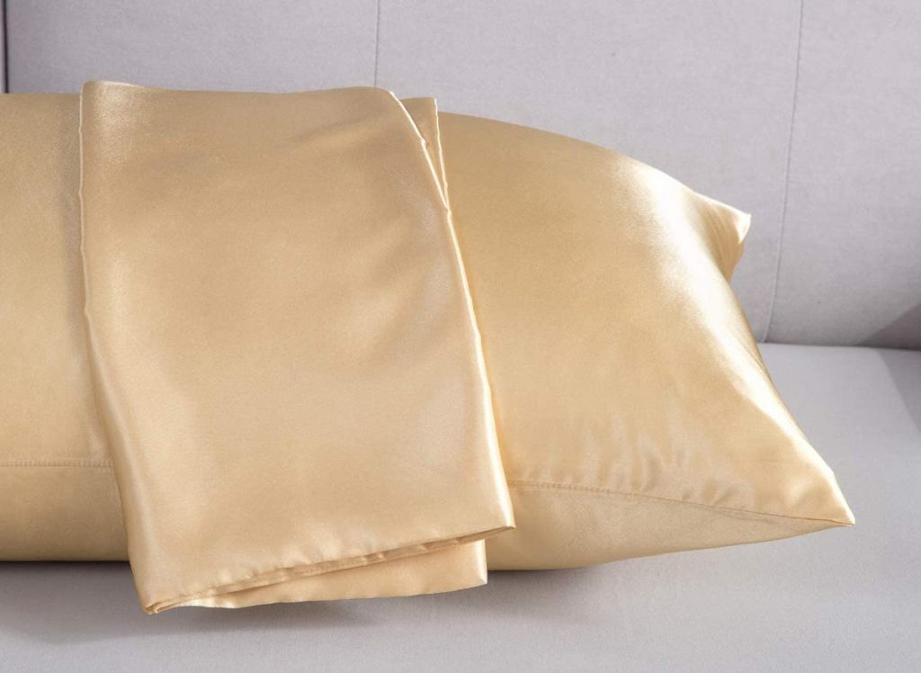 pillow with a pillowcases laid across the top