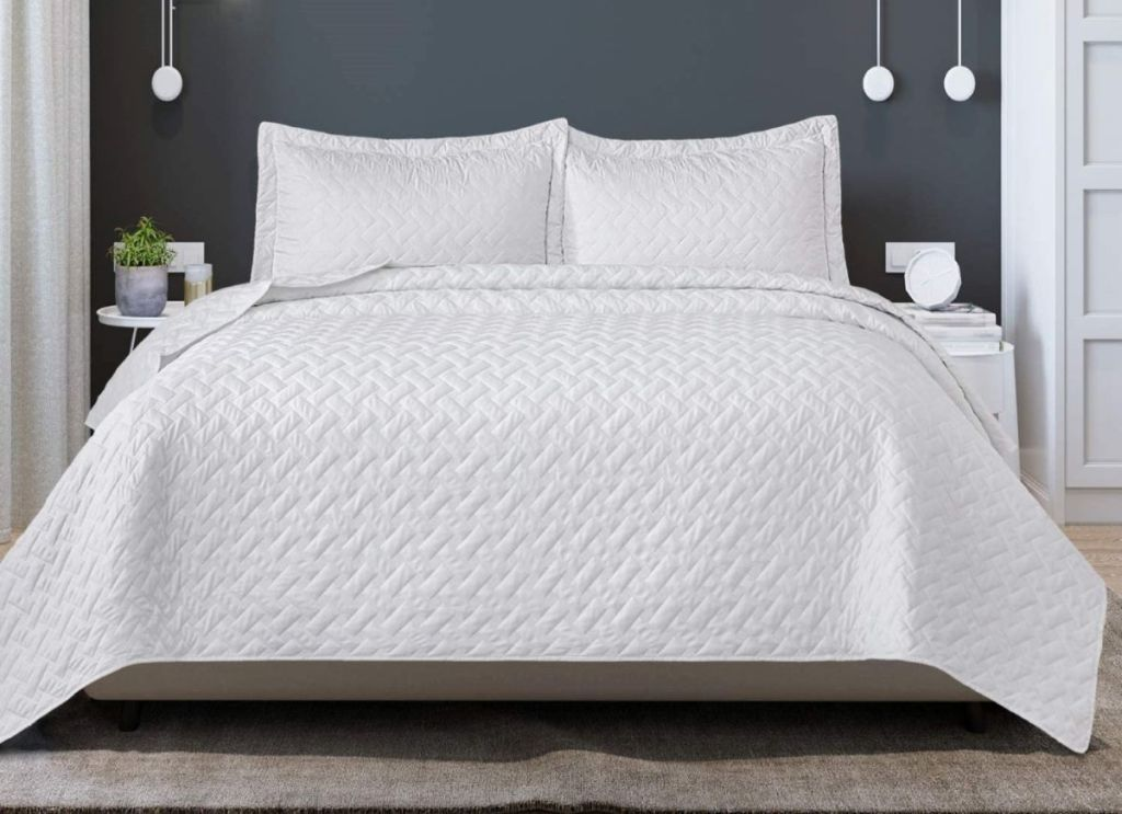 bed with white quilt on it