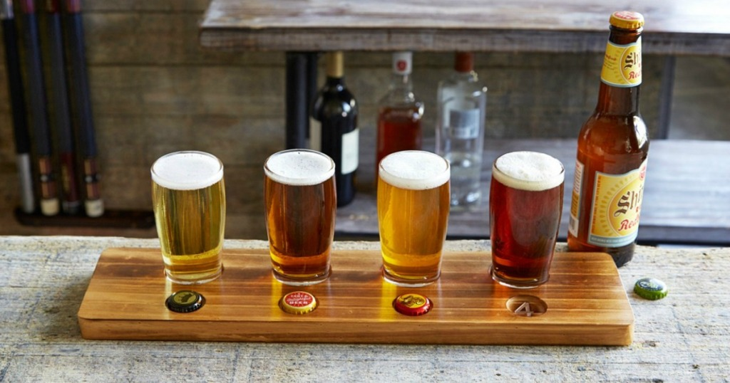 Beer Tasting 5-Piece Wood Flight Set on bar with glasses full of beer