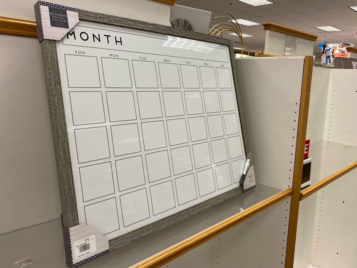 Large dry erase calendar with wooden frame on display in-store