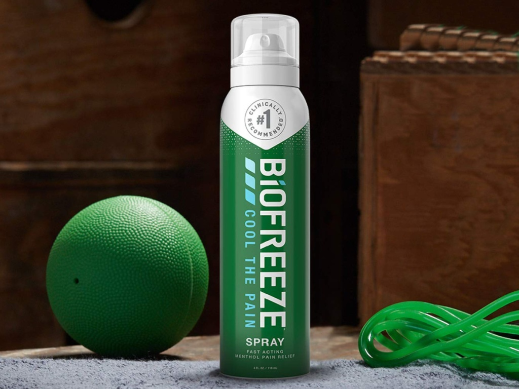 green bottle of biofree pain relief next to a ball and jump rope
