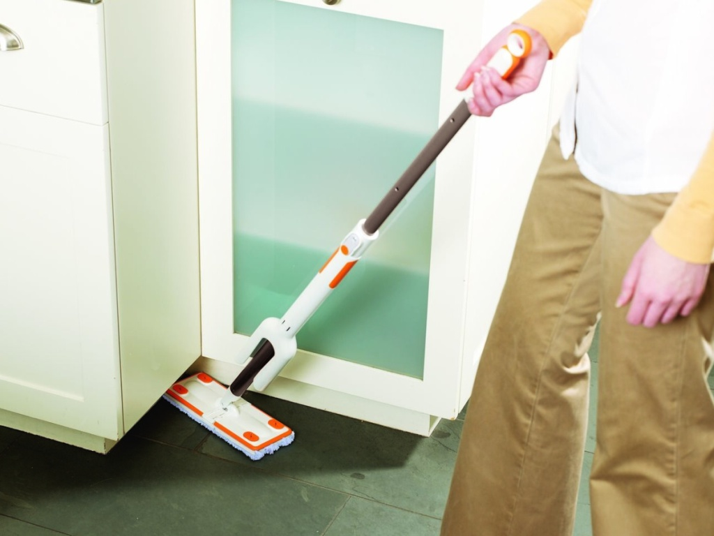 person using mop in home