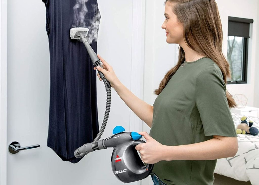 woman steaming a shirt