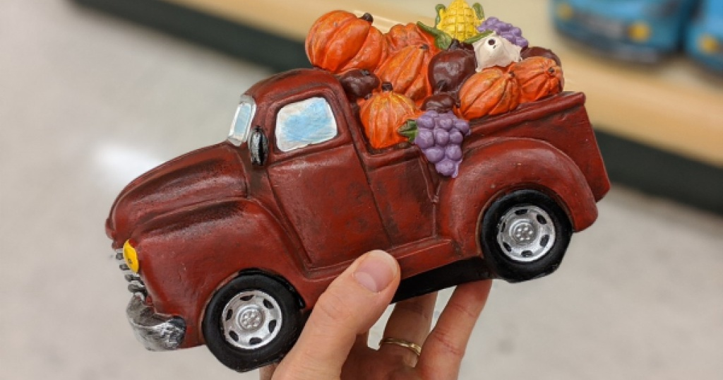 vintage red truck with pumpkins at hobby lobby