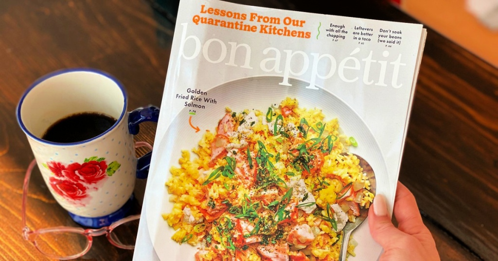Bon Appétit Magazine in woman's hand with cup of coffee and reading glasses