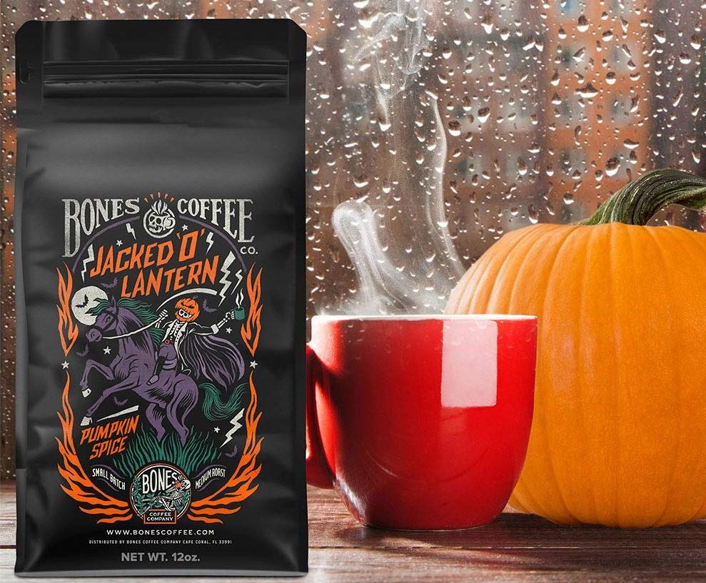 bag of coffee next to a pumpkin