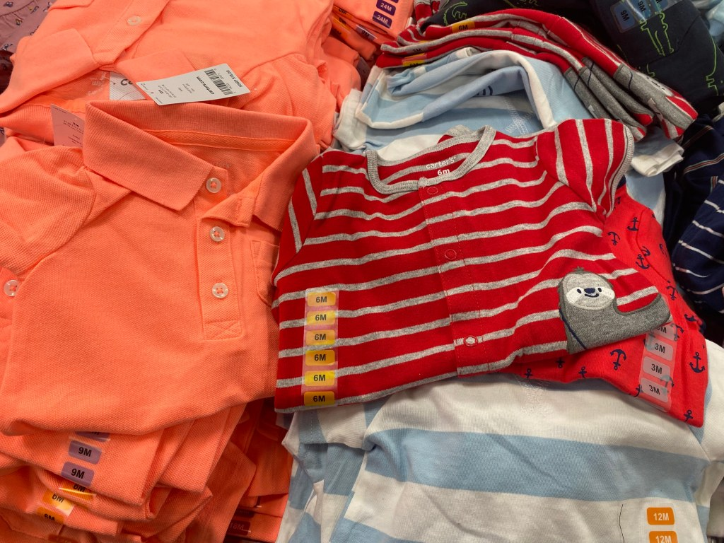 Carters Boys Rompers on display table at club