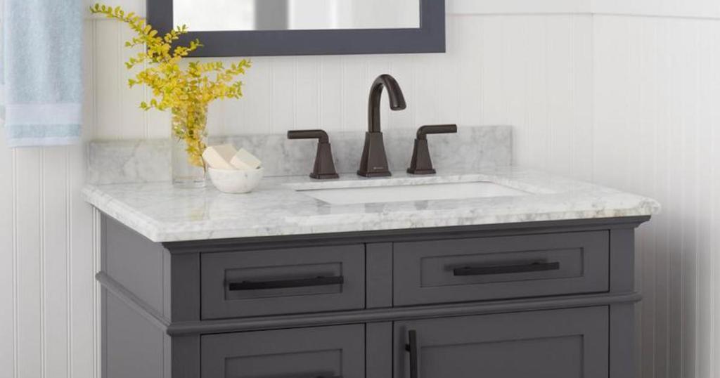 dark bronze bathroom faucet on