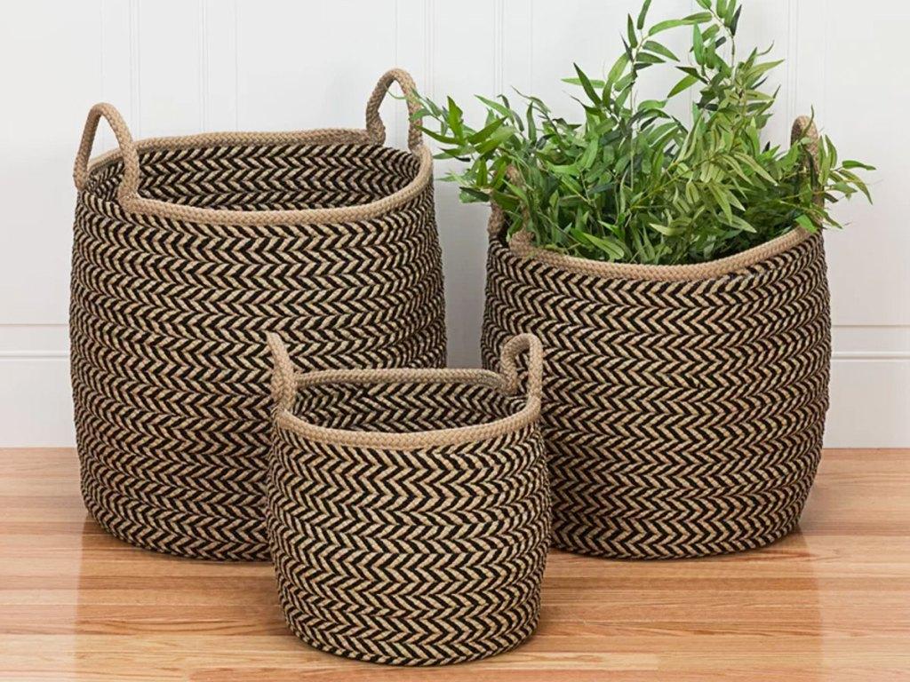 three brown and black woven baskets on hardwood floor