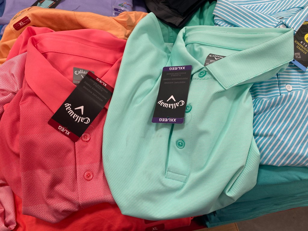 Men's Callaway Golf Shirts on display table at Sam's Club