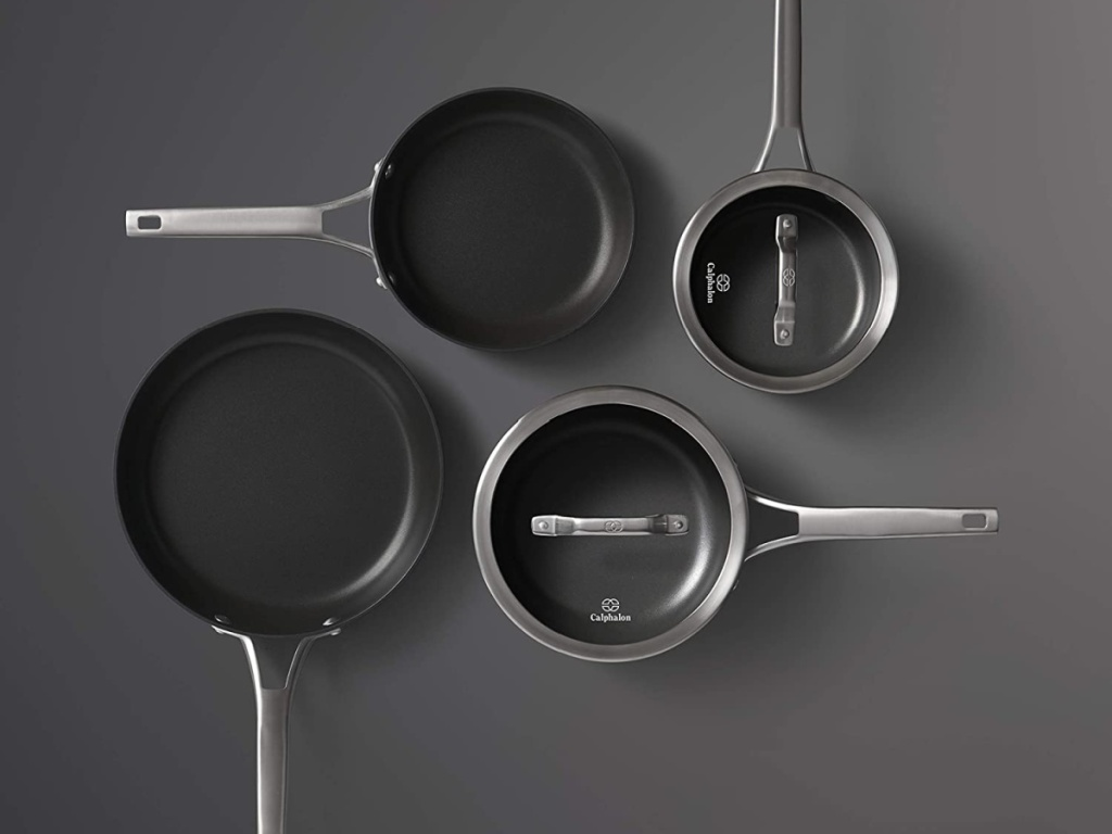 black pots and pans on gray surface