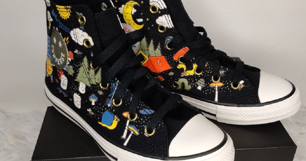 kids camp-themed black high top sneakers on black shoe box