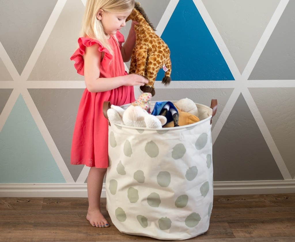 girl putting toys in a canvas bag