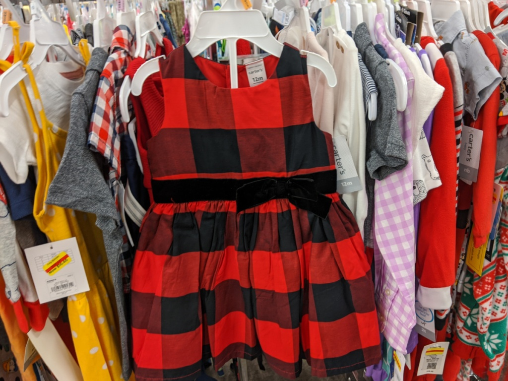 baby girls red and black buffalo check dress hanging in store