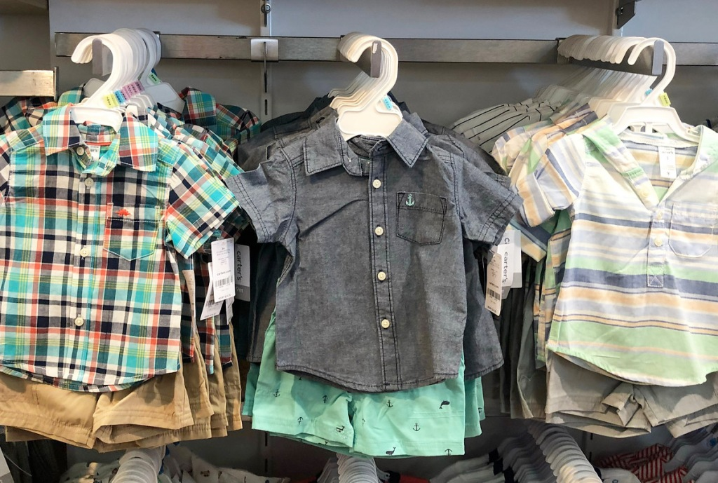 toddler boy's button up shirts and shorts sets on hangers on Carter's store display racks
