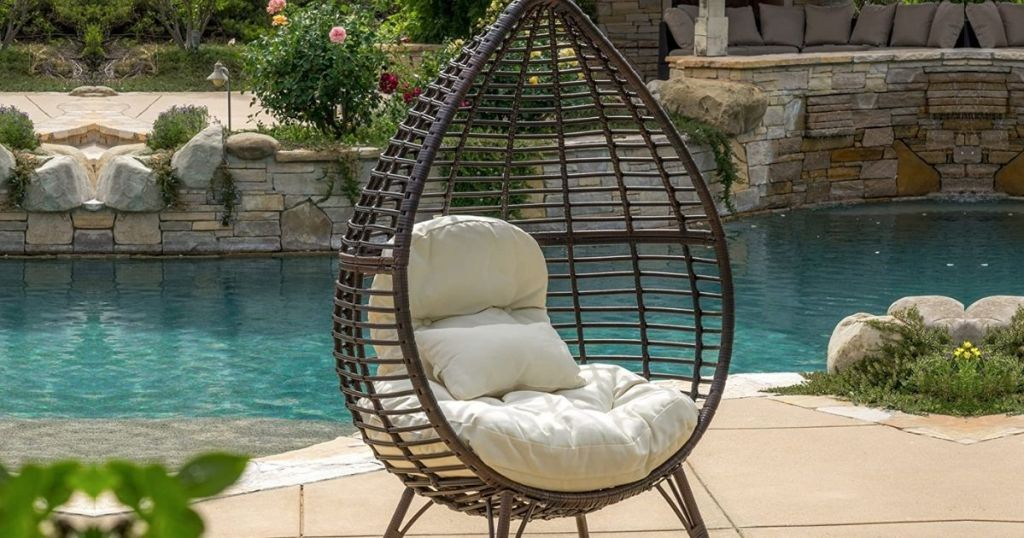 Christopher Knight Teardrop shaped chair outdoor near a pool