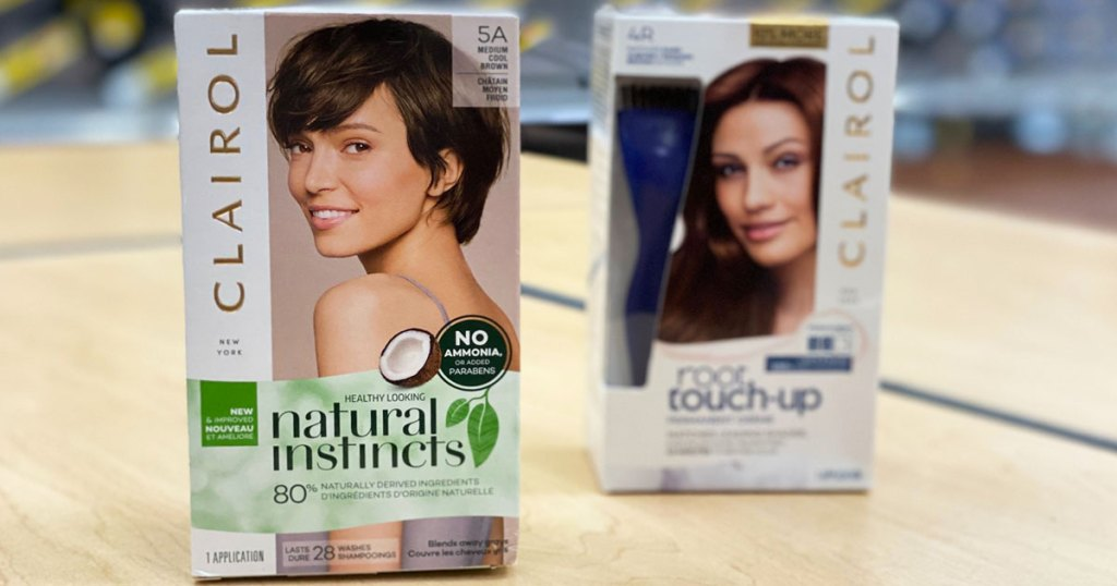 boxes of Clairol Natural Instincts and Root Touch-Up hair color on wood table
