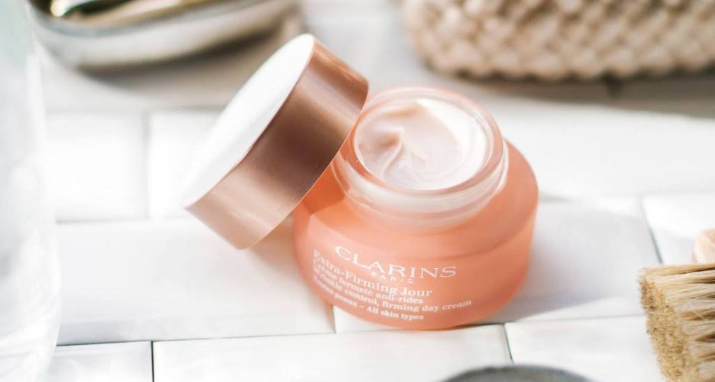 open jar of Clarins Extra-Firming Wrinkle Control Firming Day Cream Broad Spectrum SPF 15 All Skin Types