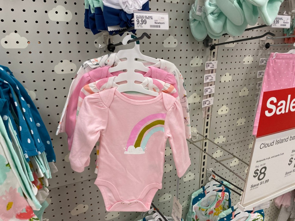 Cloud Island Bodysuits on peg display at store