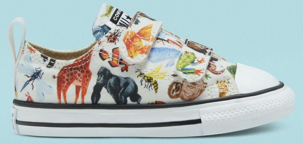 white converse with multiple zoo animals drawn on them with light blue background