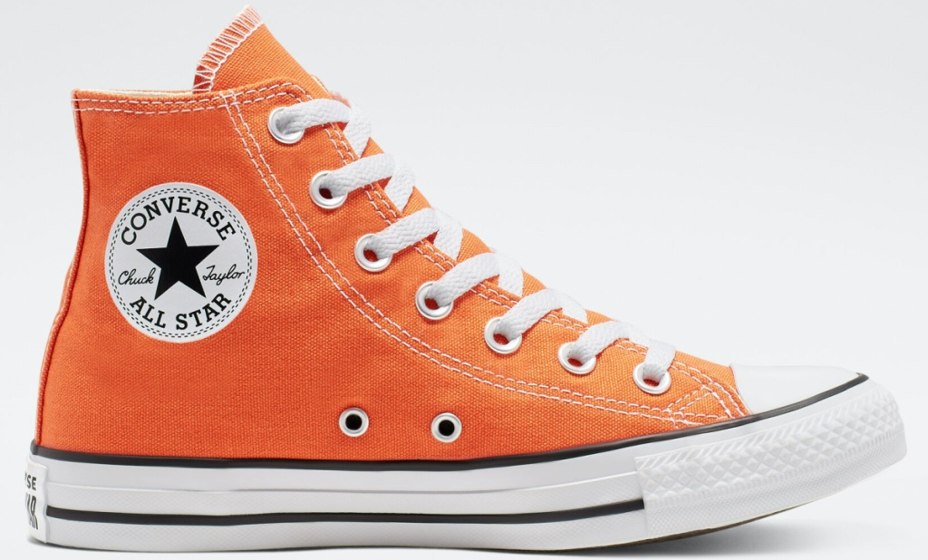 orange high top sneaker and light gray background