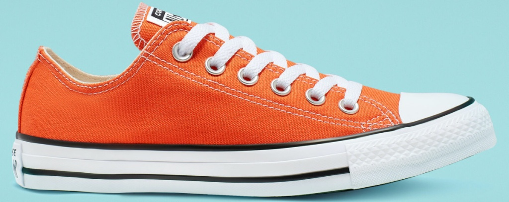 orange low top sneaker and teal background