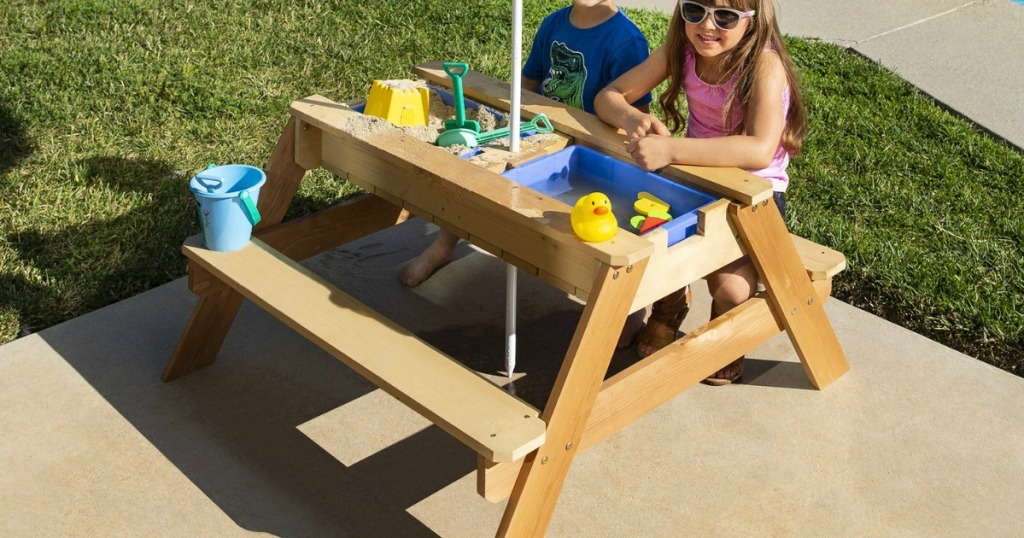 kids sitting at a Convertible Play Table