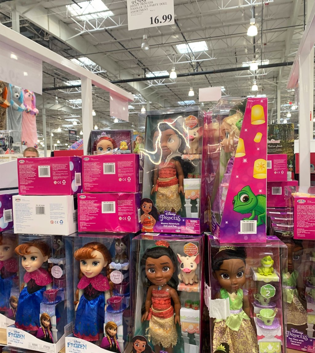Disney princess dolls stacked on a Costco display
