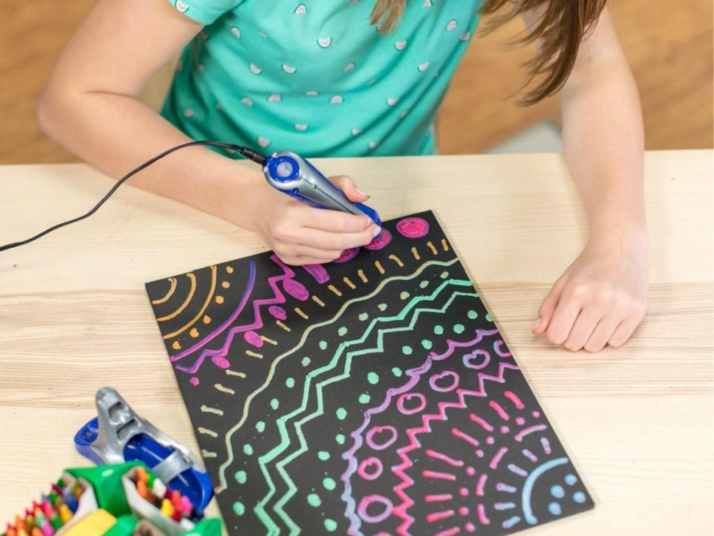 girl using crayon melter to make art