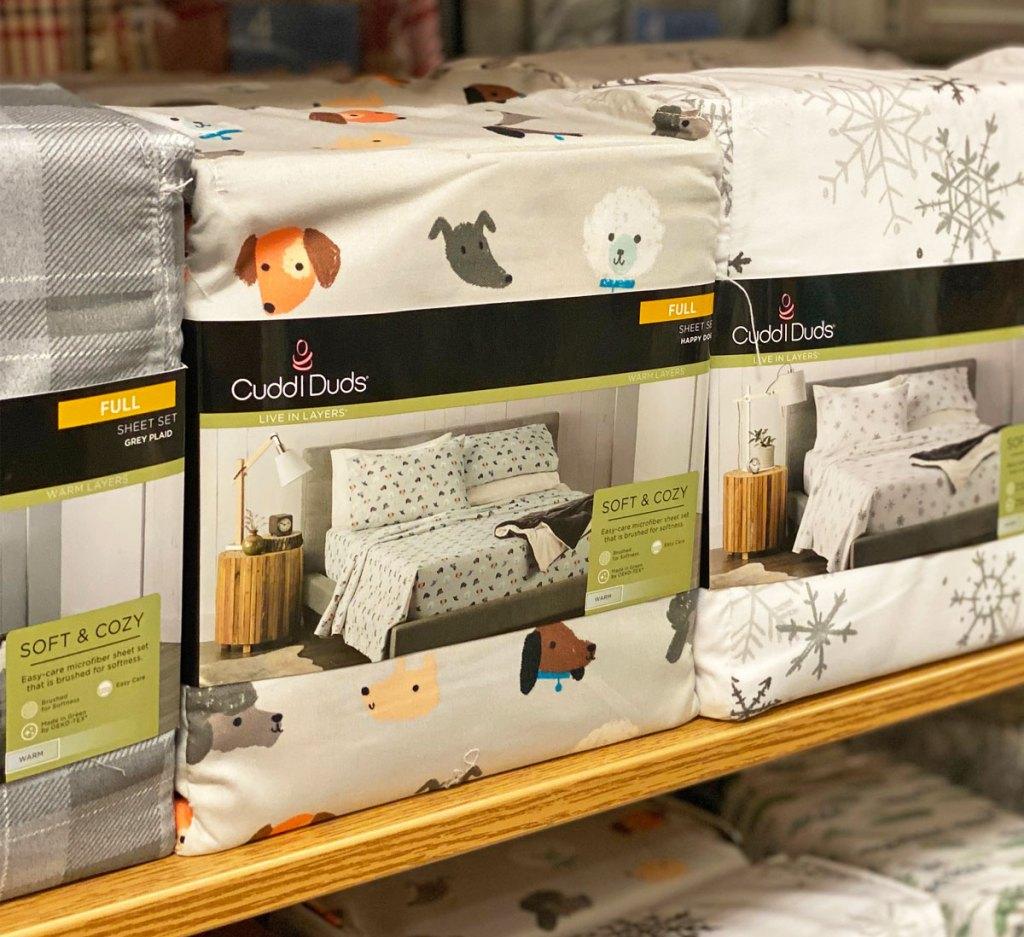 set of dog printed flannel sheet set on Kohl's display shelf