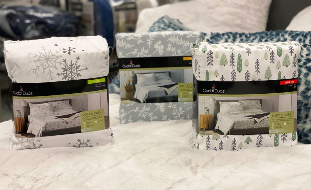 three sheet sets in christmas and winter prints on a white bed