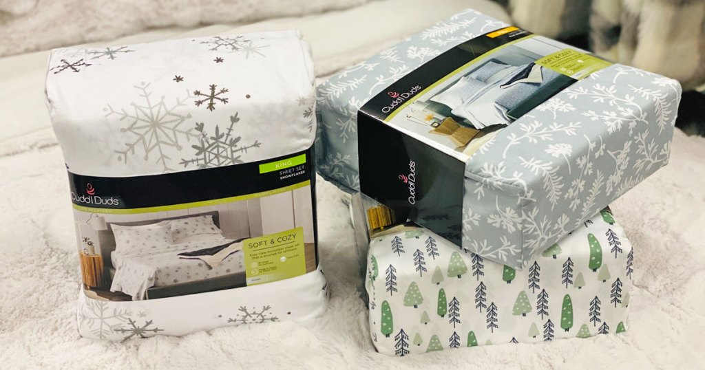 three sets of christmas printed flannel set sets on a white bed