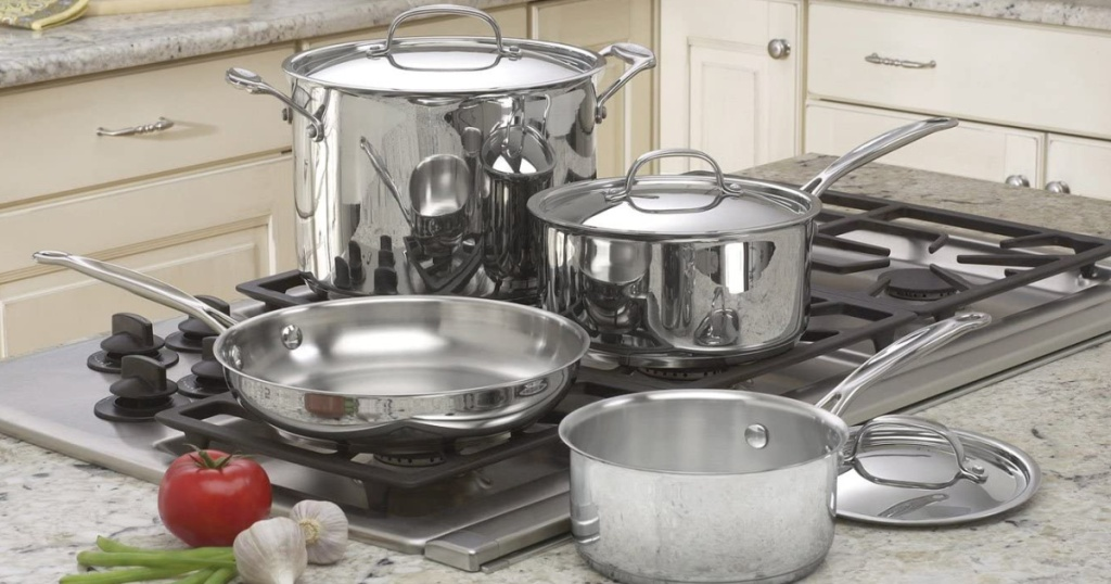 Cuisinart 7 Piece Stainless Steel Chef's Collection Cookware sitting on top of a stovetop next to vegetables