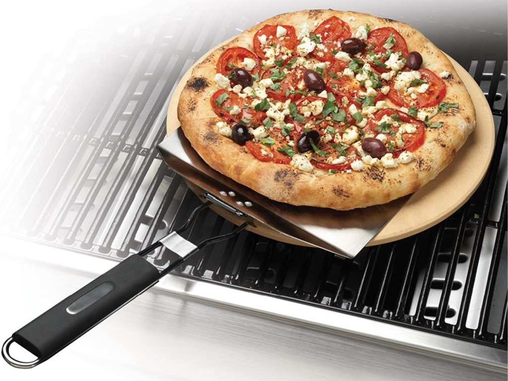 pizza on pizza pan on grill