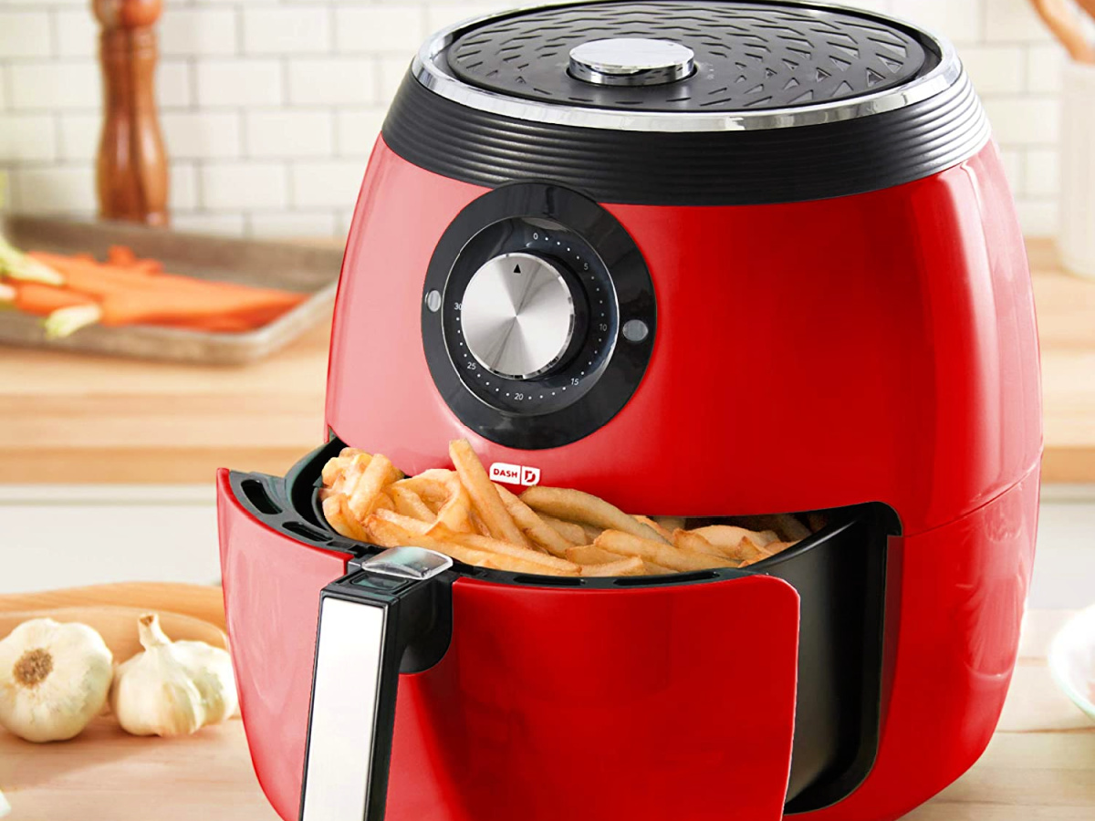 red air fryer with fries in the basket