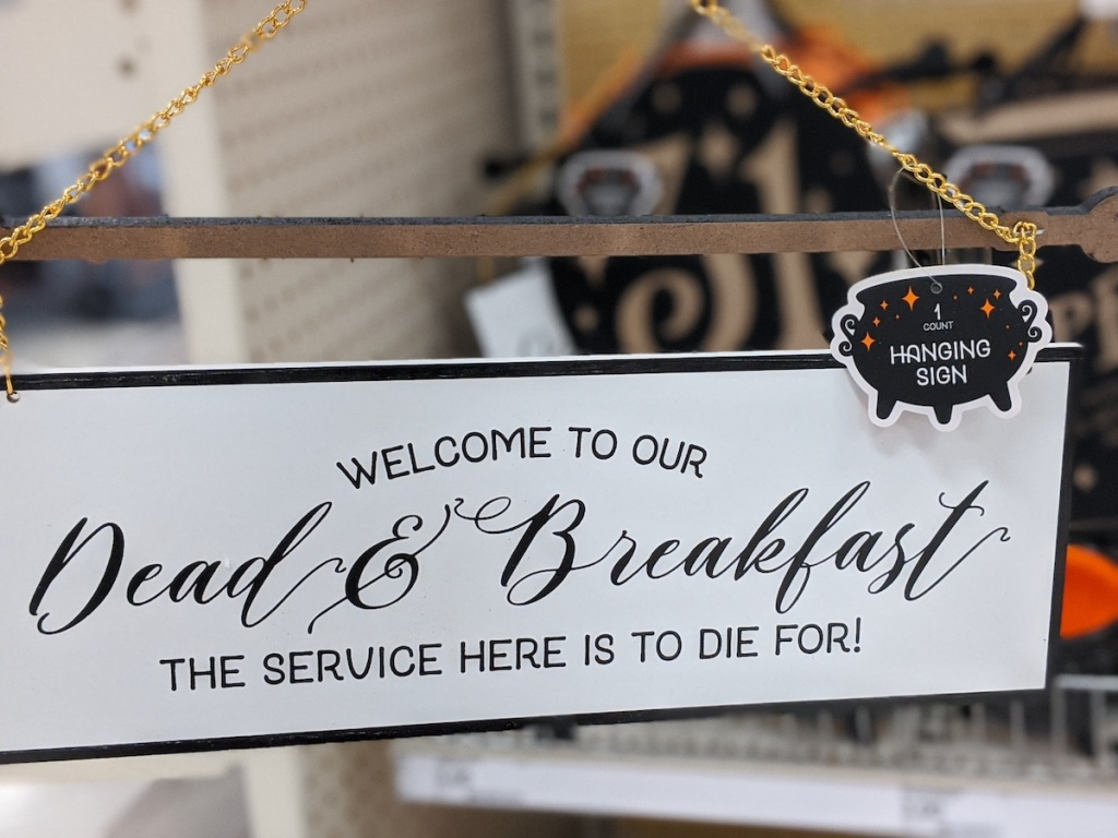hand holding Dead & Breakfast Sign at Target